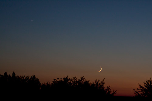 Photo: Crescent Moon and Planet Venus float in sunset sky. Photo by James Guilford
