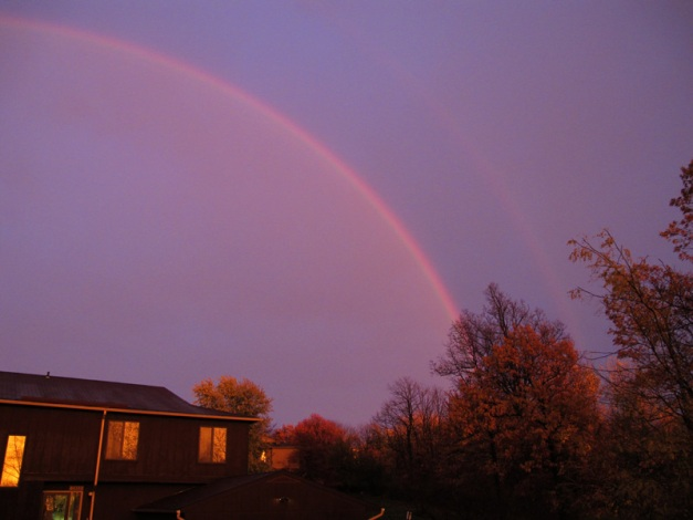 Photo: Double rainbow in darkening sky. Photo by James Guilford.