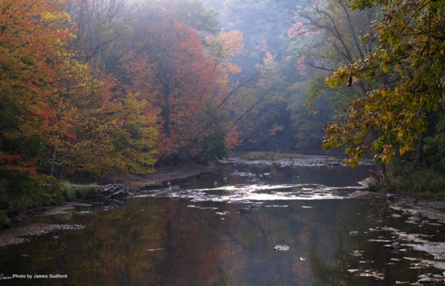 Photo: Morning fog burning off in an autumn river scene. Photo by James Guilford.