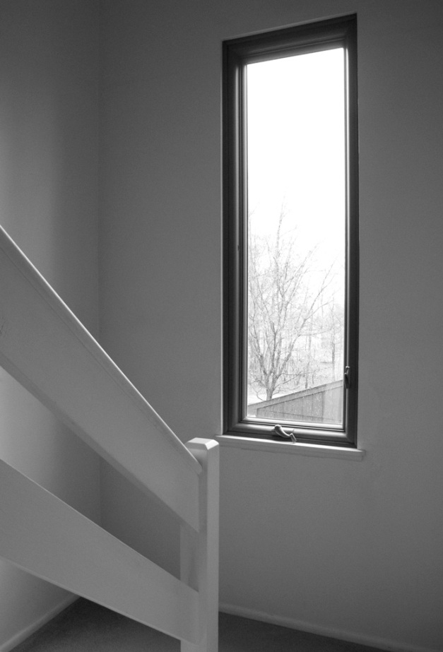 Photo: Tall window on the stairwell landing. Photo by James Guilford.