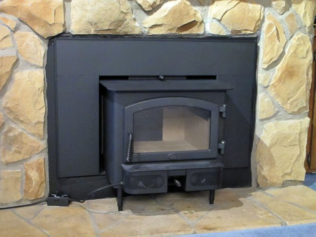 Photo: The finished installation of wood stove insert.