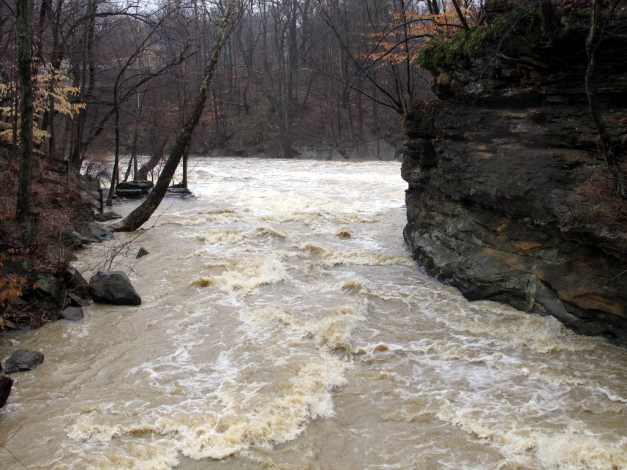 Photo: Flood waters rush through a rocky ravine. Photo by James Guilford.