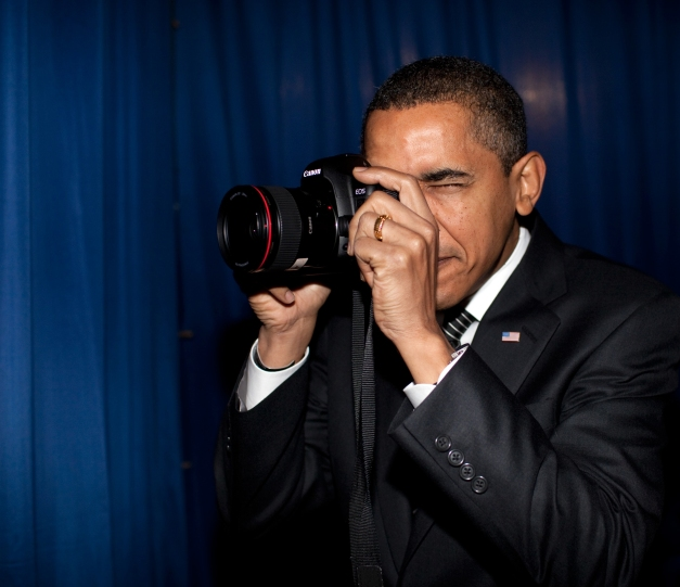 Photo: President Barack Obama holding a Canon DSLR camera.