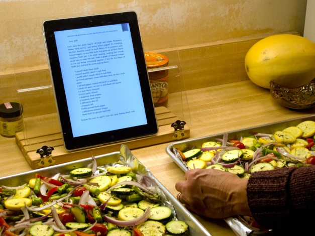 Photo: An iPad replaces a printed cook book in the kitchen. Photo by James Guilford.