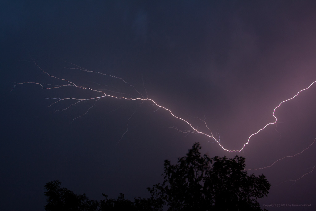 Photo: Lightning discharge in the night sky. Photo by James Guilford.