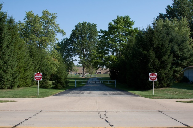 Photo: Driveway with gates and do not enter signs. Photo by James Guilford.