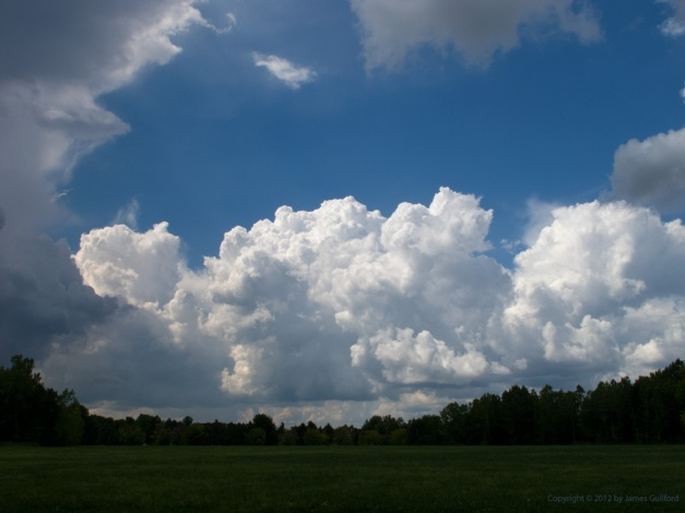 Photo: Masses of clouds against a deep blue sky. Photo by James Guilford.