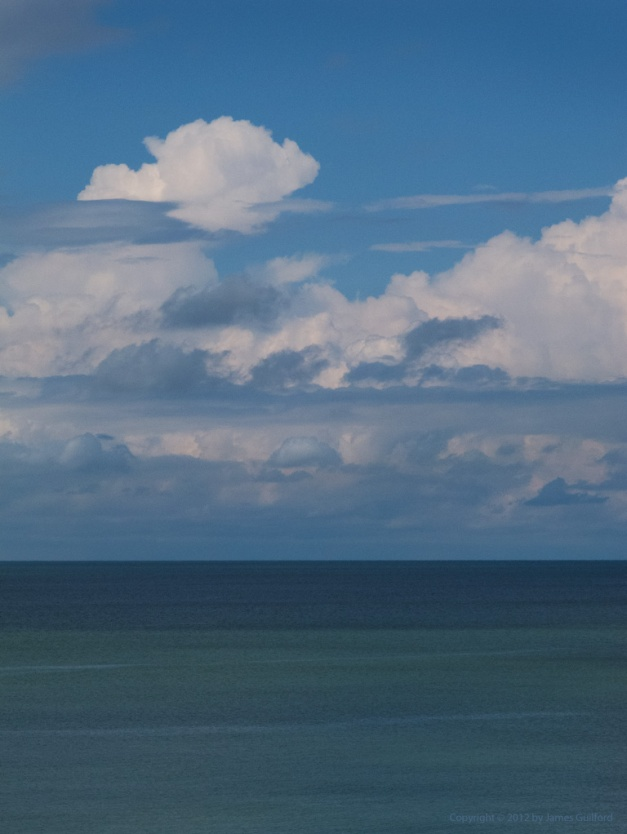 Photo: Clouds moving over colorful waters of Lake Erie in Ohio. Photo by James Guilford.