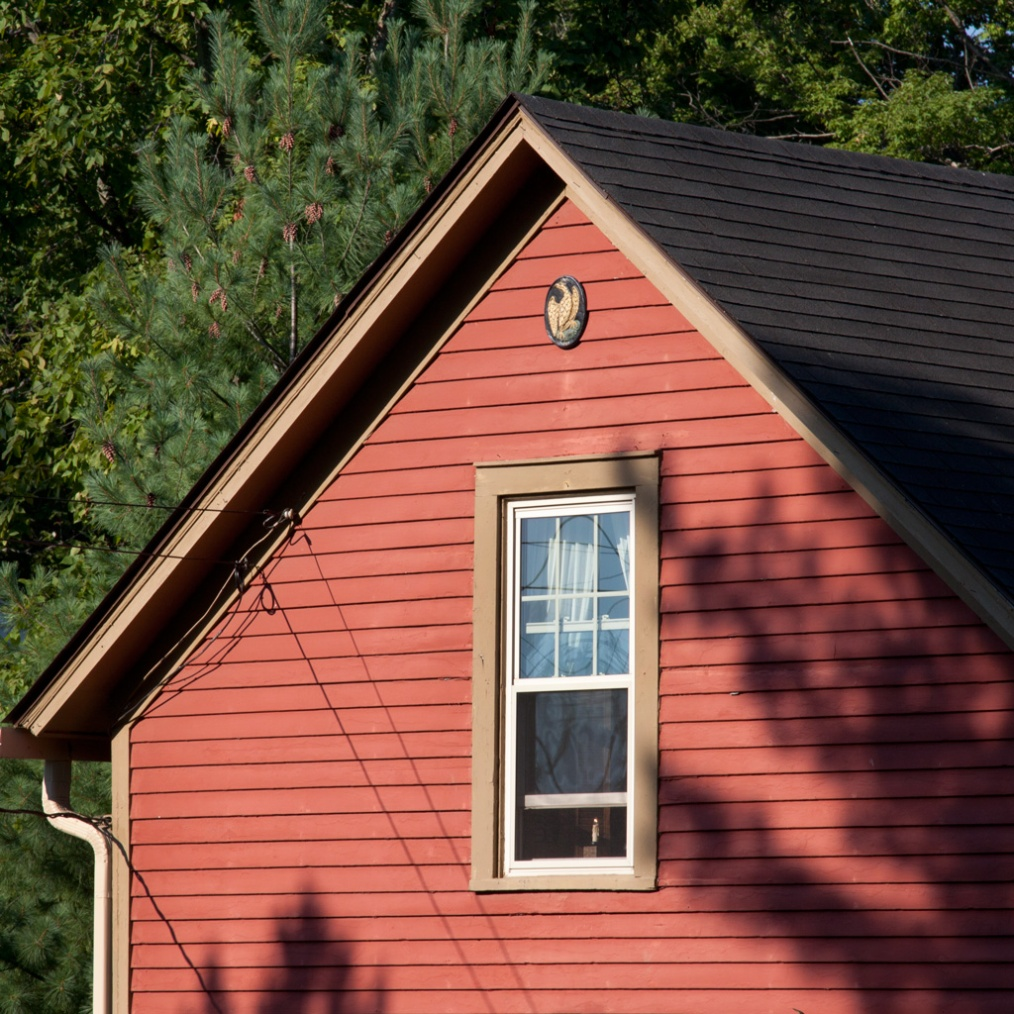 Photo: Red house in morning sunlight. Photo by James Guilford.