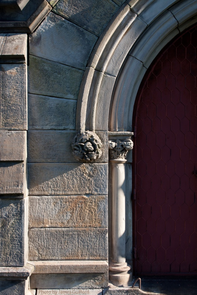 Photo: Stone arch over the entry to a mausoleum. Photo by James Guilford.
