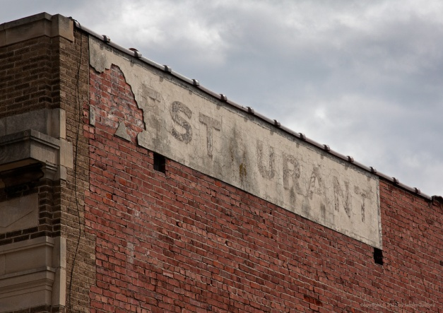 Photo: Deteriorating restaurant sign, missing first letter. Photo by James Guilford.