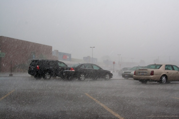 Photo: Wind-driven rain in a parking lot. Photo by James Guilford.
