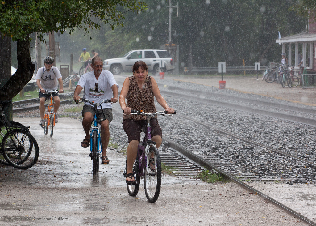 Photo: Cyclists riding in heavy rain. Photo by James Guilford.