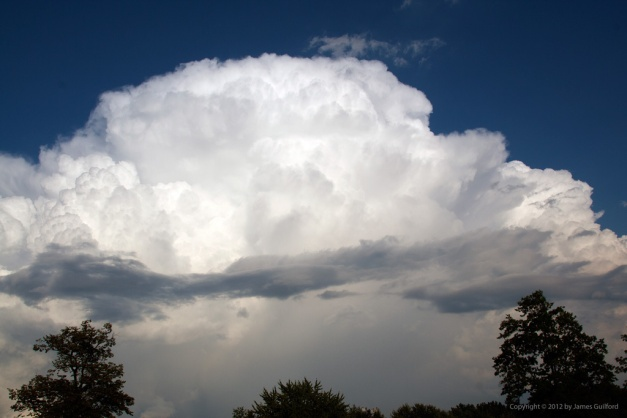 Photo: Portion of storm against deep blue sky. Photo by James Guilford.