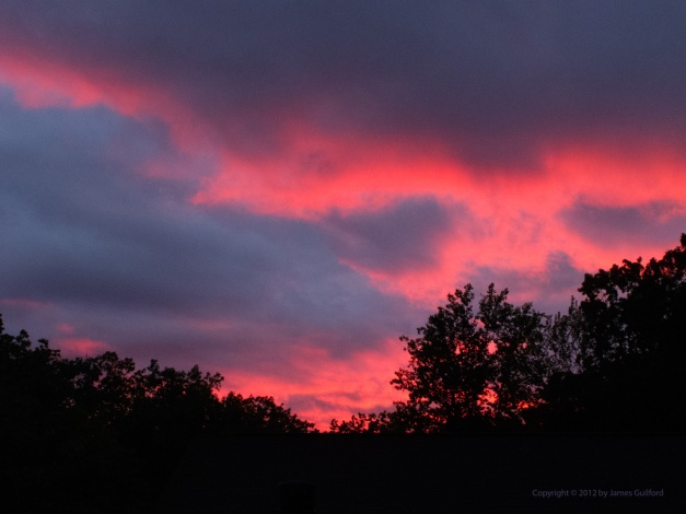 Photo: Brilliant sunset on a stormy evening. Photo by James Guilford.