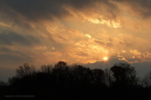 Photo: Sunrise as it is covered by clouds. Photo by James Guilford.