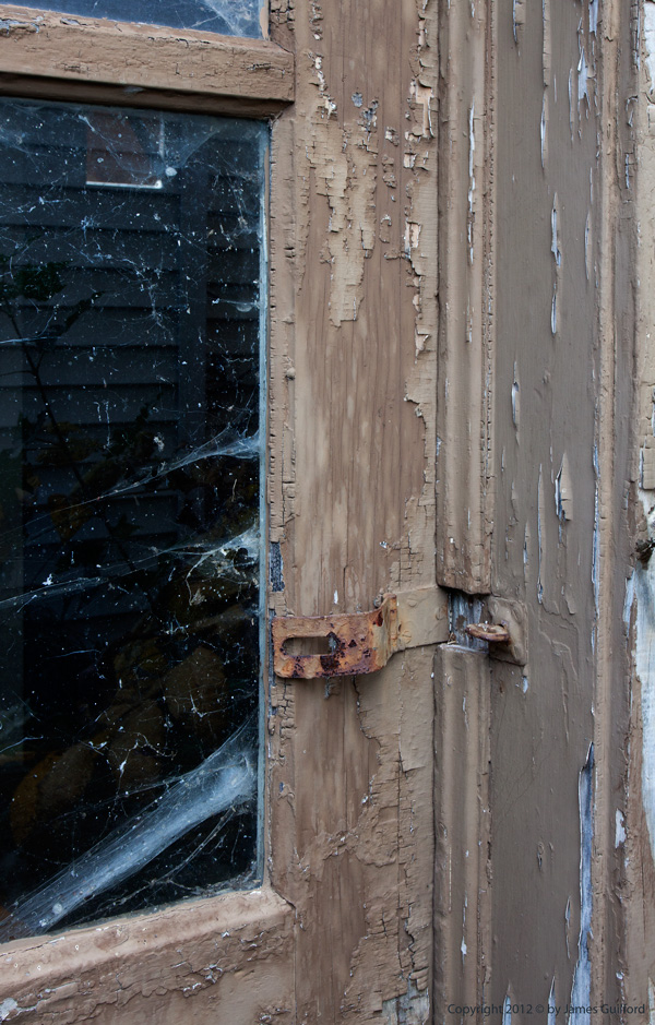 Photo: Weathered exterior door. Photo by James Guilford.