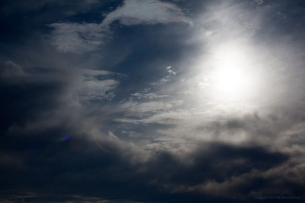 Photo: Sun and dramatic clouds. Photo by James Guilford.