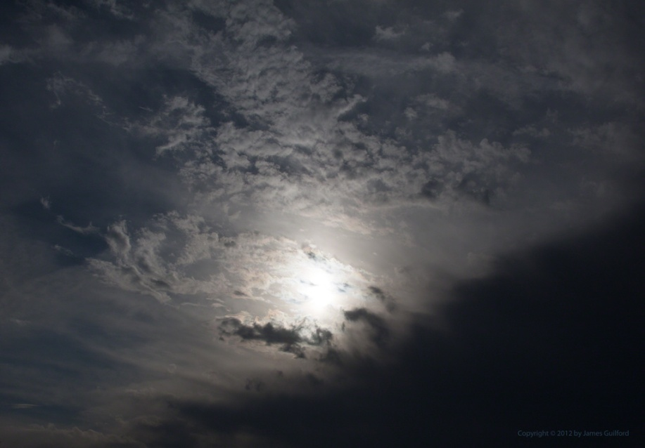 Photo: Dramatic clouds and sun. Photo by James Guilford.