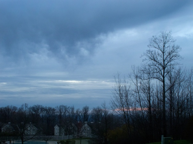 Photo: Threatening clouds over homes. Photo by James Guilford.