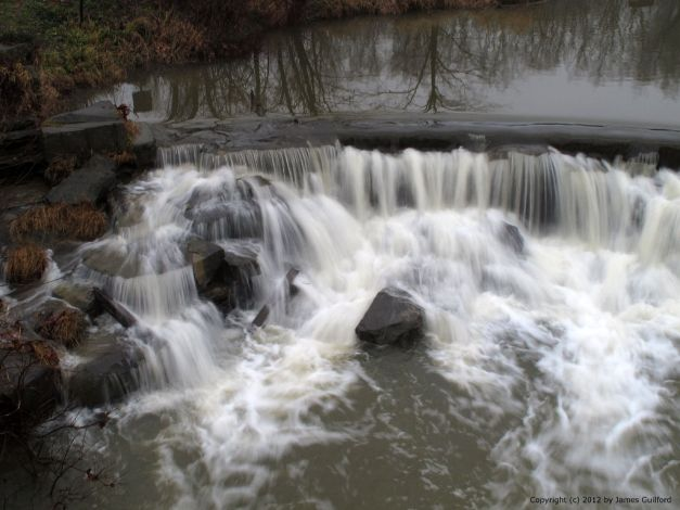 Photo: Water over a dam. Photo by James Guilford.