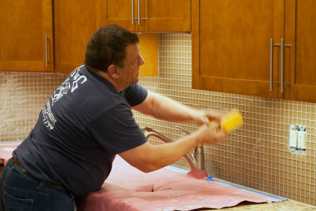 Photo: Wet-wiping tile. Photo by James Guilford.