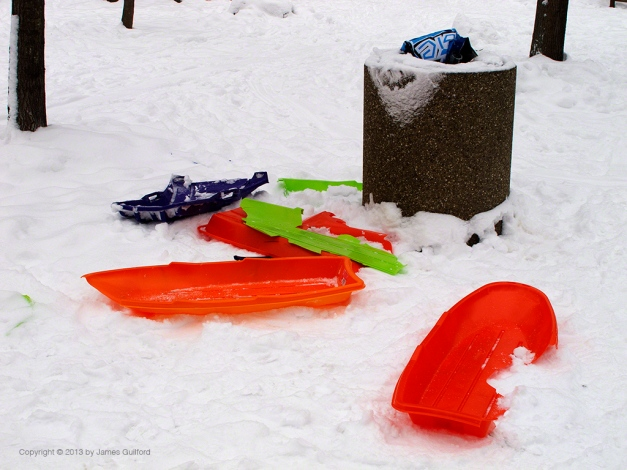 Photo: Broken, discarded plastic sleds. Photo by James Guilford.