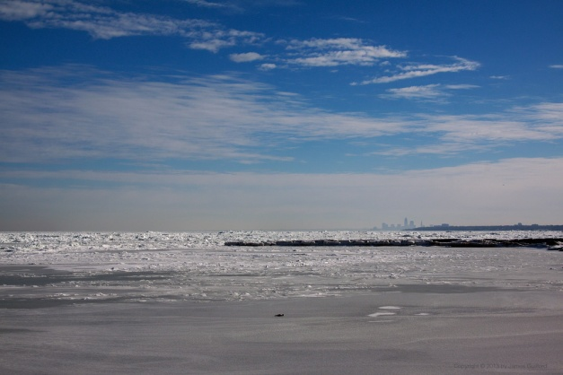 Photo: Icy lake and beach in the Greater Cleveland Area. Photo by James Guilford.