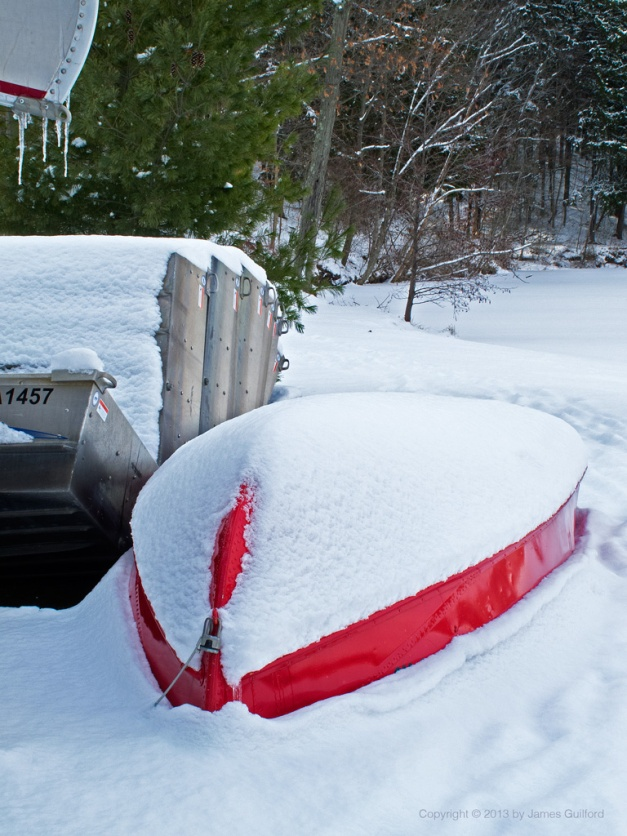 Photo: Boats covered with snow and ice. Photo by James Guilford.