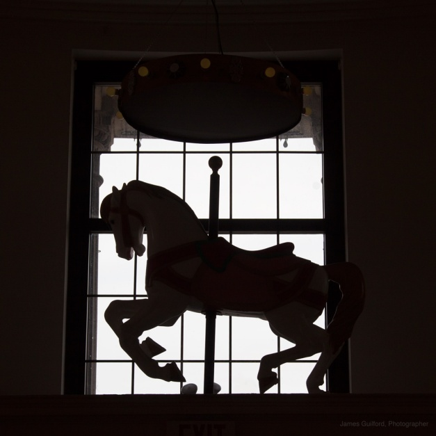 Photo: Silhouette of a carousel horse.