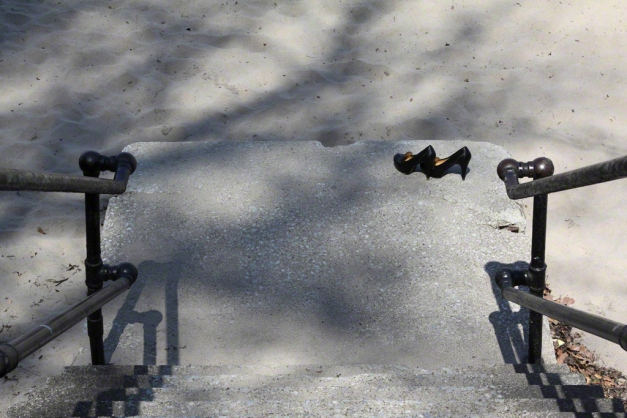 Photo: Women's shoes on concrete landing at beach. Photo by James Guilford.