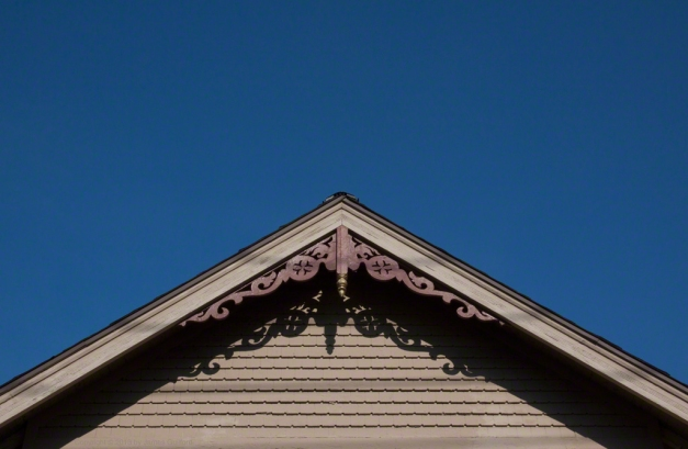 Phhoto: Peak of the roofline of an old house. Photo by James Guilford.