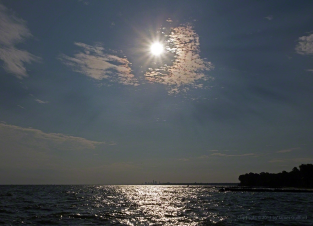 Photo: Sun over Lake Erie with Cleveland Skyline in distance. Photo by James Guilford.