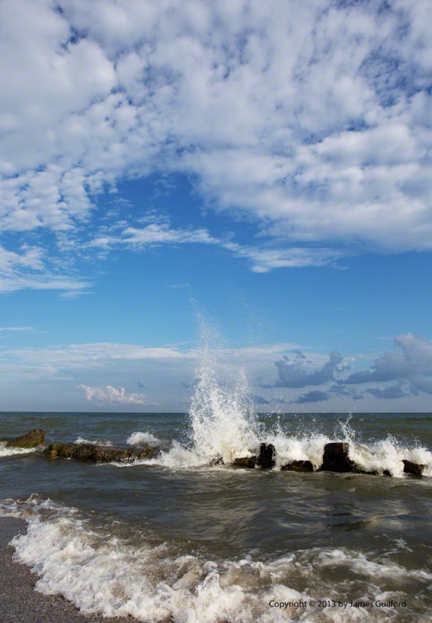 Photo: Waves crashing on a Lake Erie break wall. Photo by James Guilford.