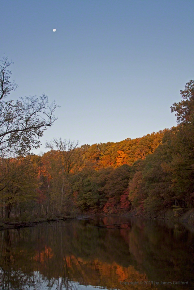 Photo: Still waters, autumn colors, and Moon. Photo by James Guilford.