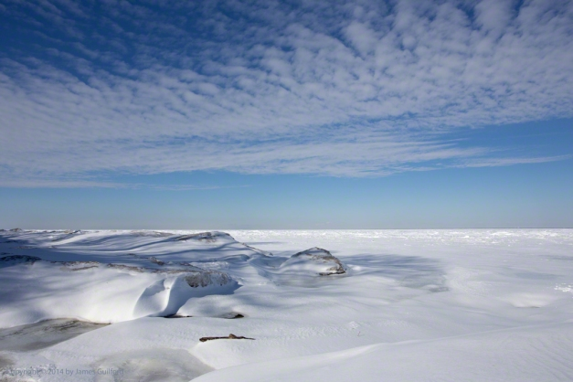 Photo: Piles of broken ice, covered with snow, under a blue sky along the south shore of Lake Erie. Photo by James Guilford.