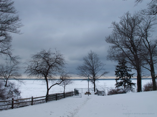 Photo: Dark skies dominate view of lakefront park. Photo by James Guilford.