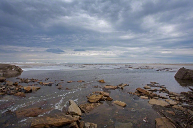 Photo: Dramatic sky over waters flowing to a still-icy Lake Erie. Photo by James Guilford.