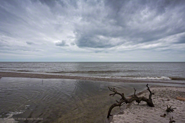Photo: Calm Lake Erie with Gloomy Clouds Overhead. Photo by James Guilford