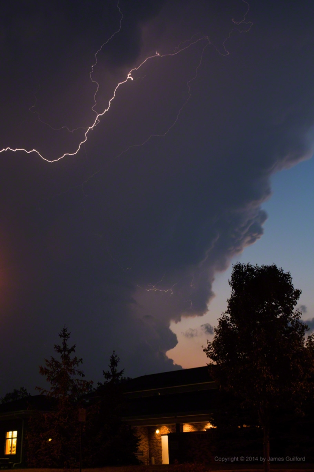 Photo: A lightning-filled thunderstorm arrives overhead. Photo by James Guilford.