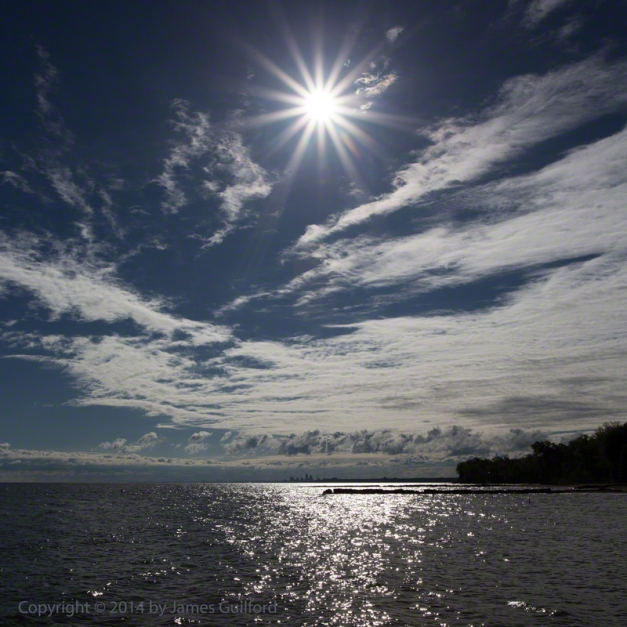 Photo: Sunburst over lake waters. Photo by James Guilford.