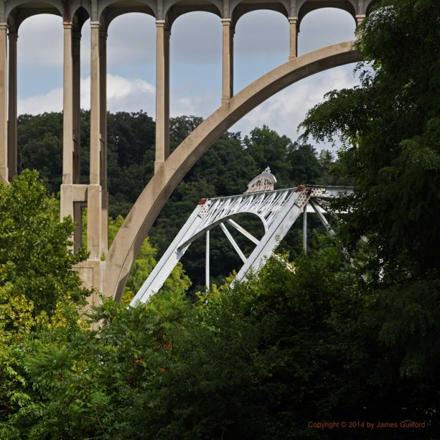 Photo: A pair of bridges in a wooded valley. Photo by James Guilford.