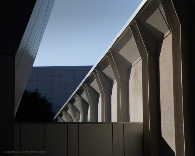 Photo: Intersecting lines and shadows of buildings. Photo by James Guilford.