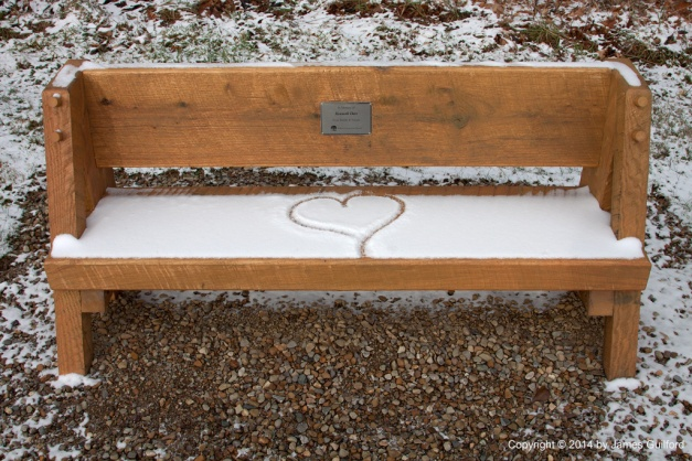 Photo: Hand-drawn heart on memorial bench. Photo by James Guilford.