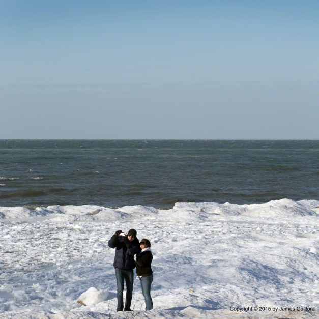 Photo: A couple poses for a self-portrait on beach ice in Vermilion, Ohio, on New Year's Day, 2015. Photo by James Guilford.