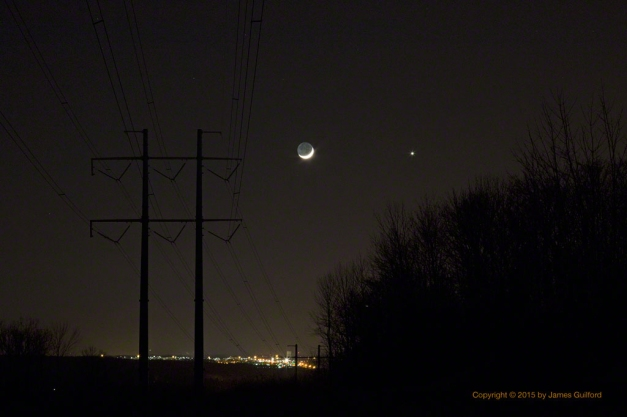 Photo: Moon and Venus in conjunction over city lights. Photo by James Guilford.