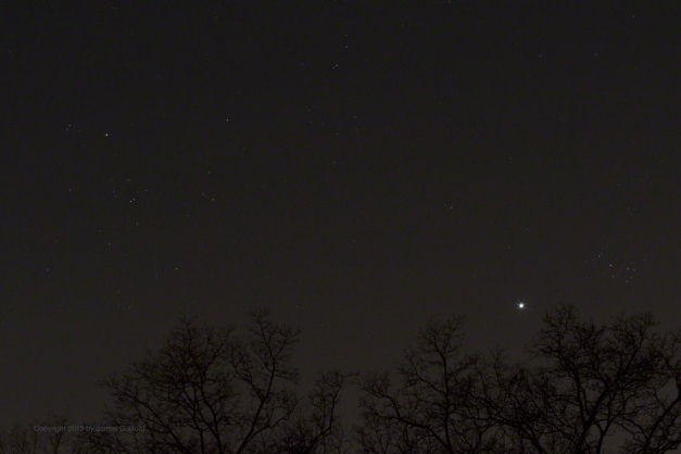 Photo: Planet Venus between the Hyades and Pleiades star clusters. Photo by James Guilford.