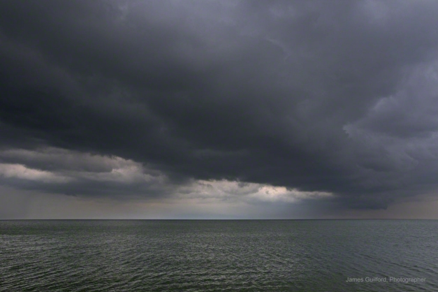 Photo: Arc of storm clouds extends northward over Lake Erie. Photo by James Guilford.