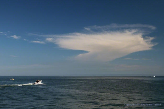 Photo: Storm cloud over Lake Erie with speed boat heading out. Photo by James Guilford.
