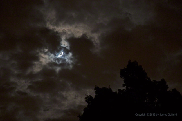 Photo: Full Moon among clouds. Photo by James Guilford.